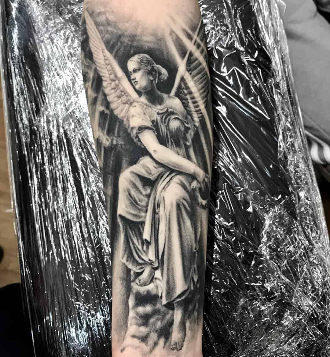 Tattoo angel by @yotovtattooart