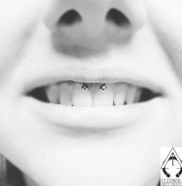 smiley piercing by @walktheline.tattoostudio