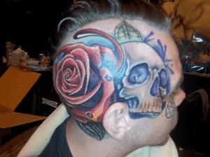 Tattoo viso Christian Sechrist