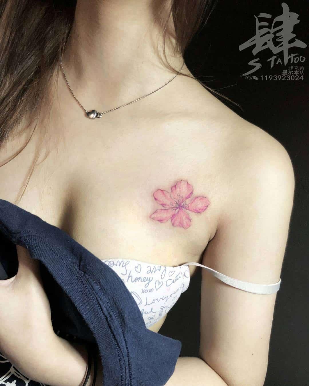 tattoo fiore di pesco by @tattooist.kyle