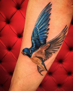 swallow tattoo by @simone_pettorossi_tattoos