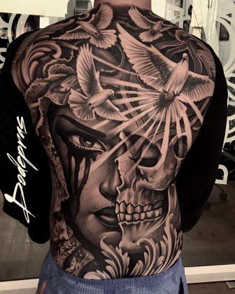Tattoo metà teschio metà donna