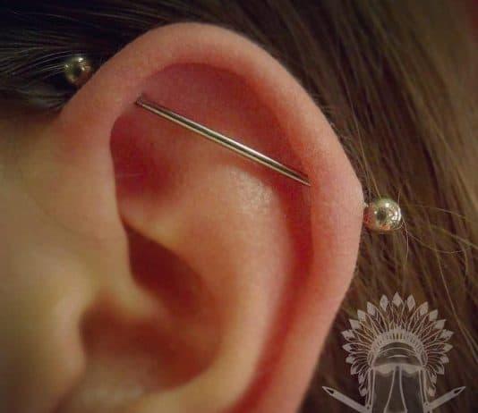 piercing industrial by @tikitattooshop
