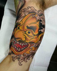 oni mask tattoo by @inmanencia.tattoo