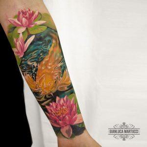 Tattoo carpa koi e fiori di loto