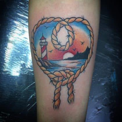tatuaggio faro tramonto mare by @martyremo
