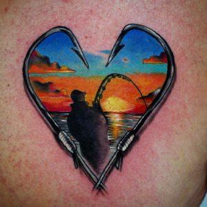 tatuaggio mare tramonto pesca cuore by @stefanogollinelli